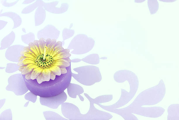 flower candle on floral background stock photo