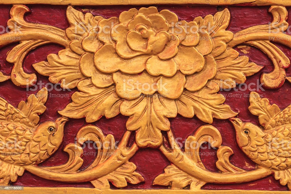 flower carved on wood gm