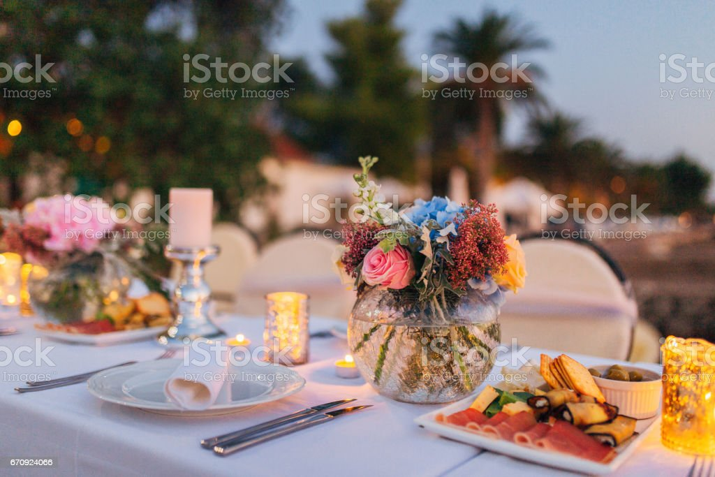 Flower compositions on the wedding table in rustic style. Wedding decorations with their own hands stock photo