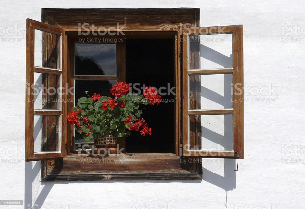 Flower decorated rural window royalty-free stock photo