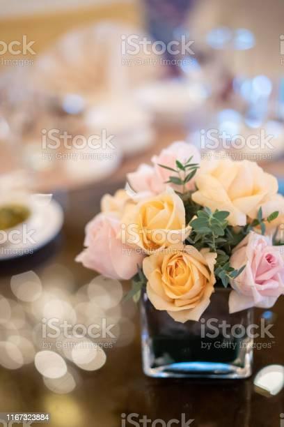 Flower decoration on wedding banquet table with defocussed background picture id1167323884?b=1&k=6&m=1167323884&s=612x612&h=9qeayczipr6ii0pqqem1xe dtzoxfo6ghbl5qfu qiq=