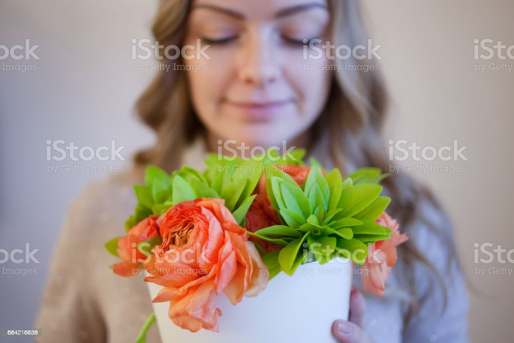 Flower delivery to the office. Young happy woman holding beautiful bouquet 免版稅 stock photo