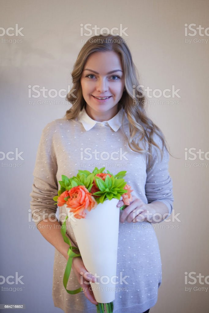 Flower delivery to the office. Young happy woman holding beautiful bouquet royalty-free stock photo