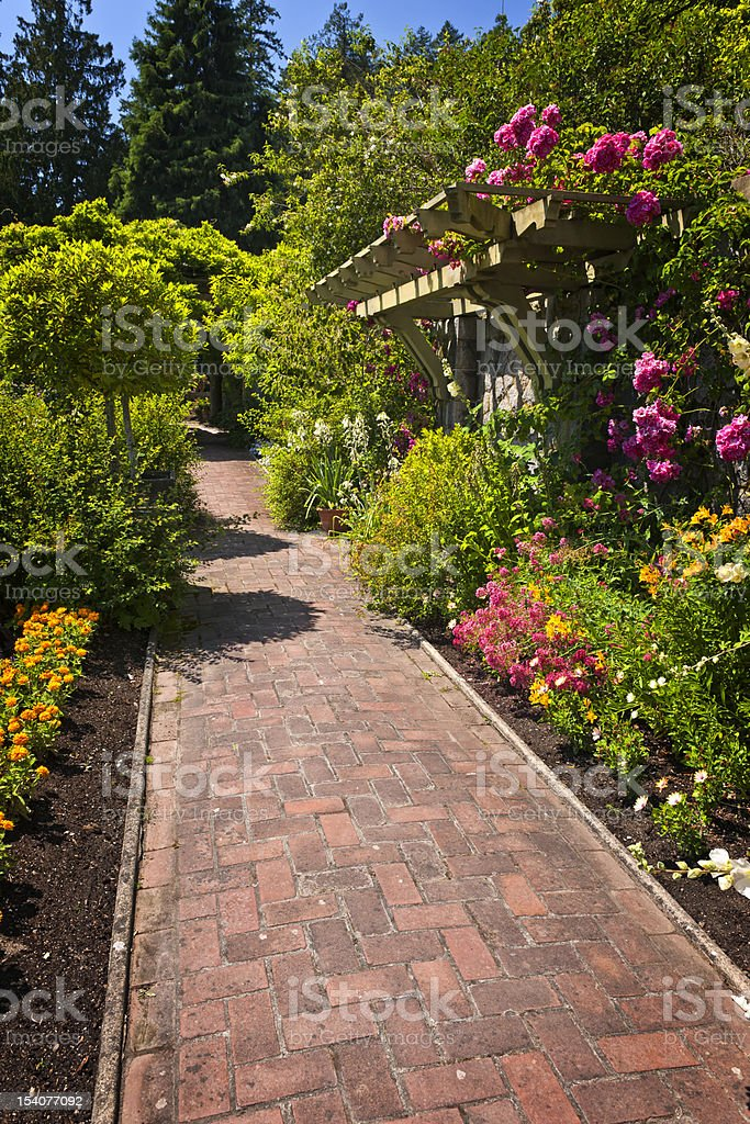 Flower garden with paved path royalty-free stock photo