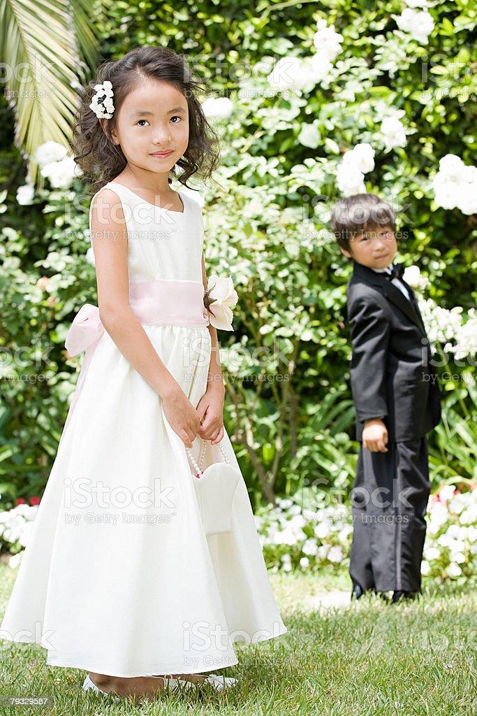 Flower girl and ring bearer stock photo