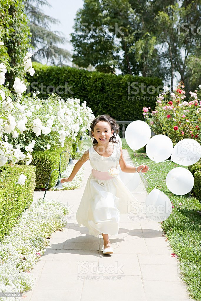 Flower girl with balloons 免版稅 stock photo