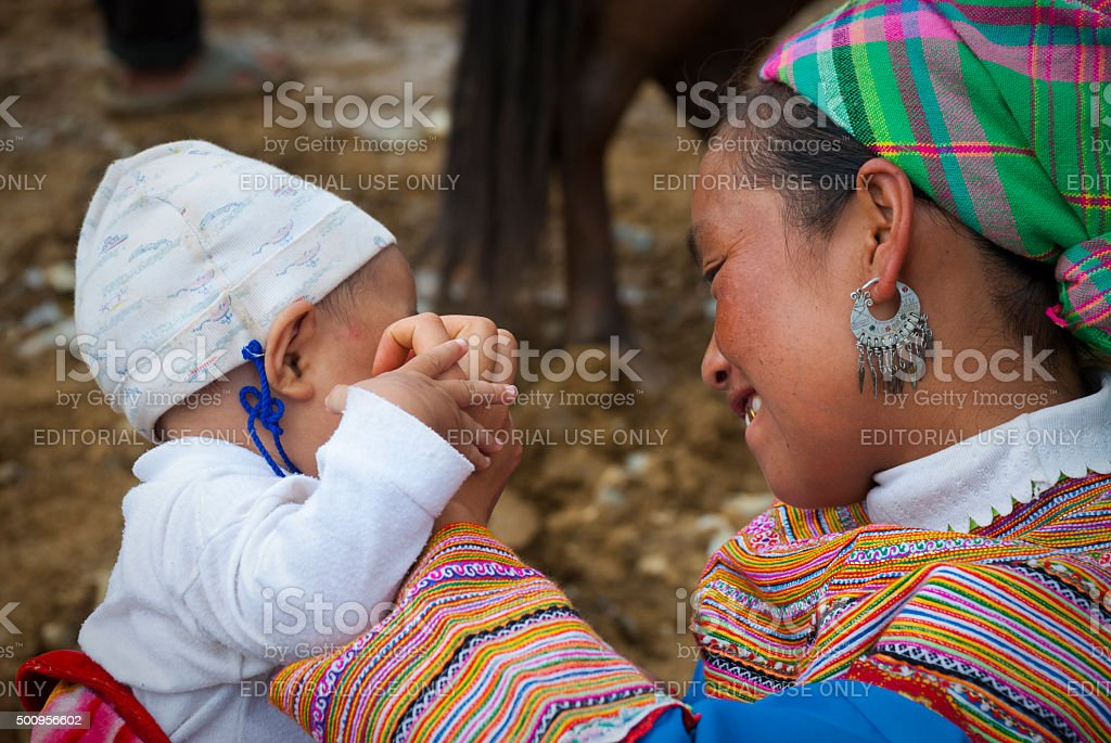 Flower Hmong mother and baby in Vietnam stock photo