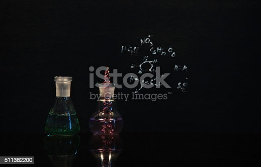 istock flower in beaker and flask lab science 511382200