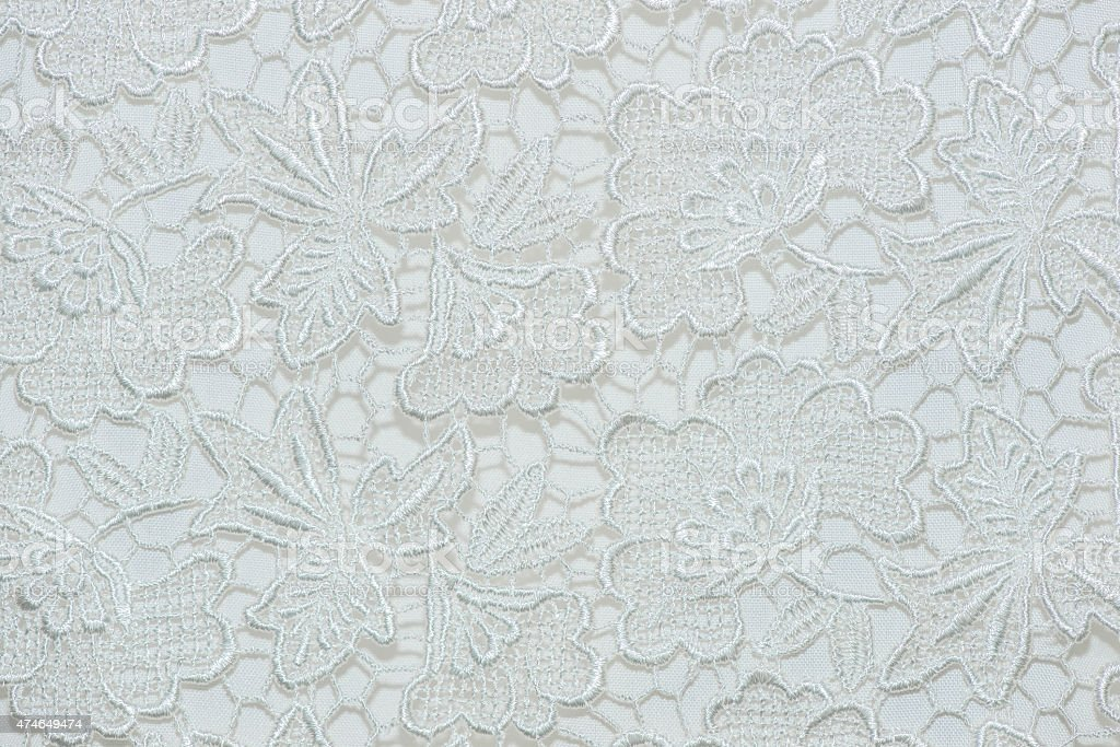 Flower lace pattern on fabric. stock photo