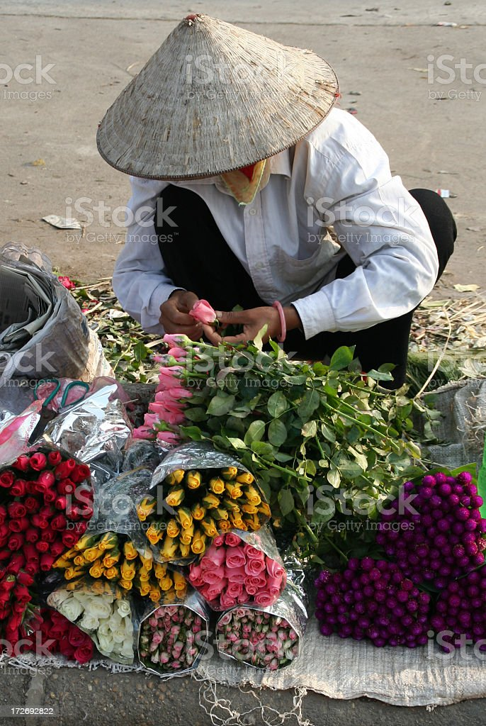 flower lady in hanoi royalty-free stock photo