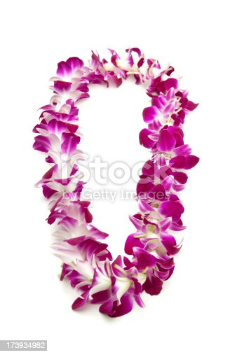 Graduation lei on white.
