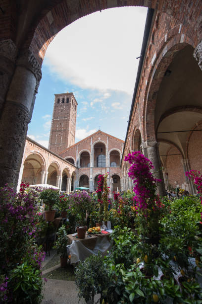 Flower market Milan, Italy - April 16, 2016: Flower marker at Basilica di Sant'Ambrogio in Milan, Italy. romanesque stock pictures, royalty-free photos & images