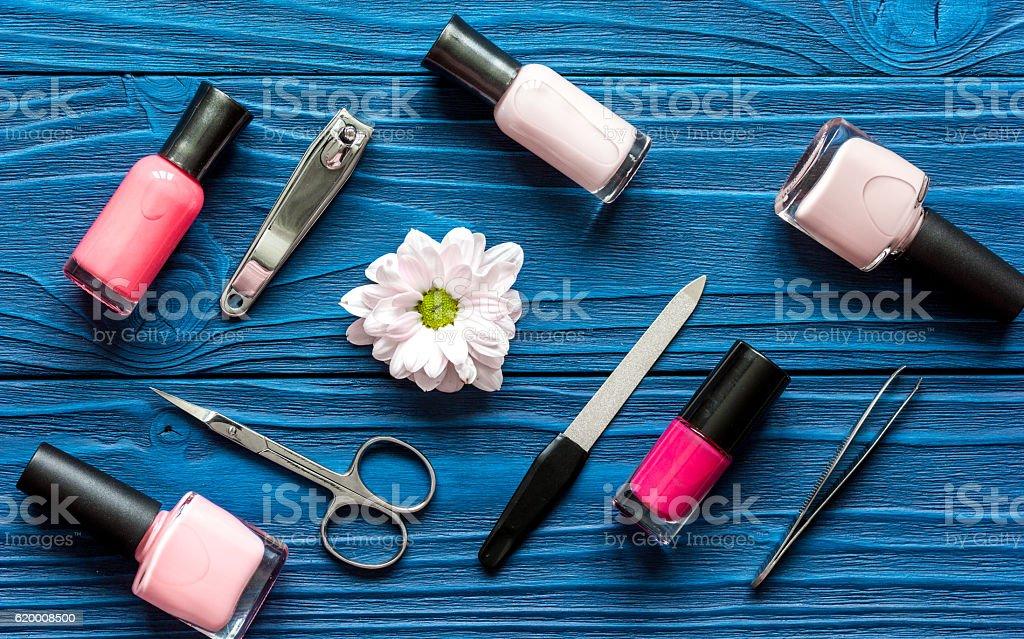 flower, nail polish and manicure set on dark wooden background zbiór zdjęć royalty-free
