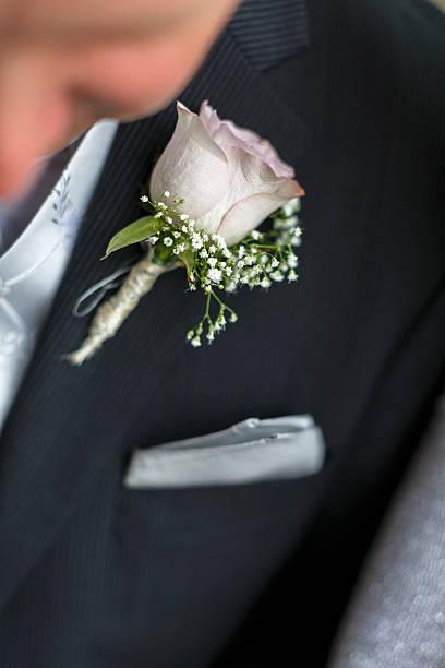 Flower on the groom. stock photo