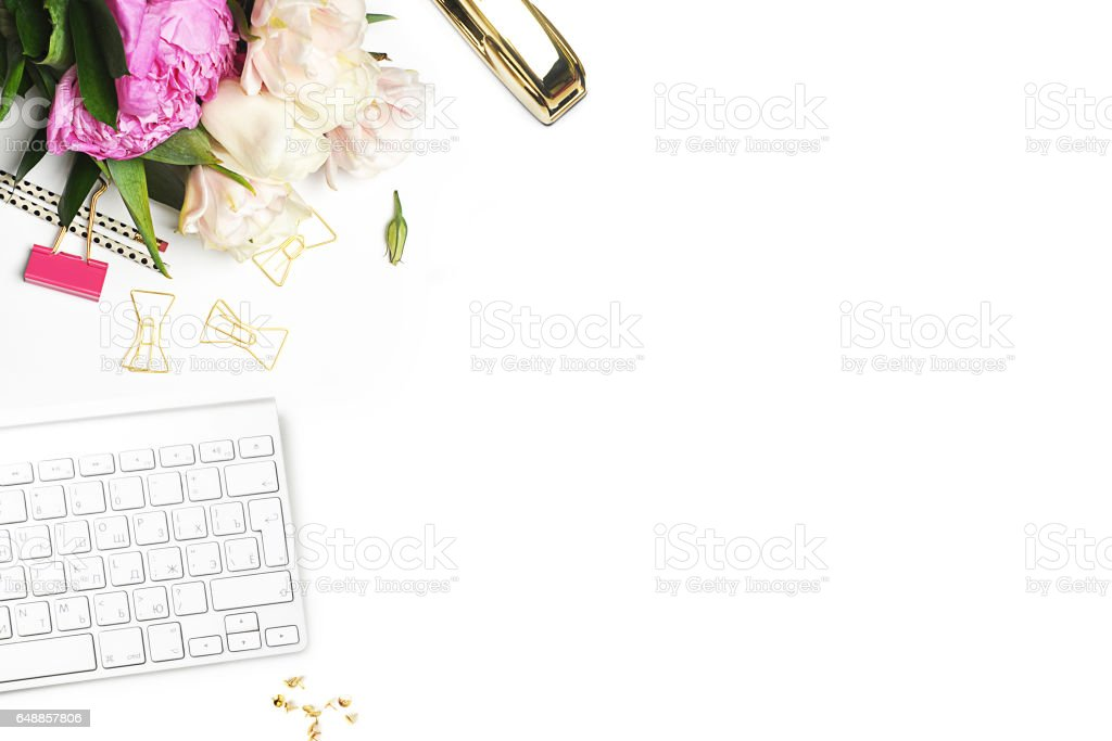 Flower on the table. Keyboard and stapler. Home workplace. Table view. Mock-up background. Peonies stock photo