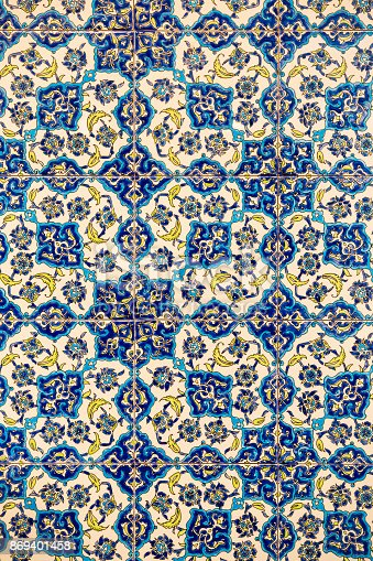 istock flower patterns on ceramic tiles in the old Turkish style, detail of an Izmir-style patterned wall tile, texture of tiles turkey 869401458