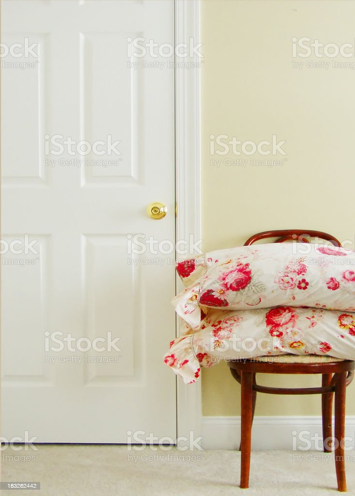 flower pillows on a chair royalty-free stock photo