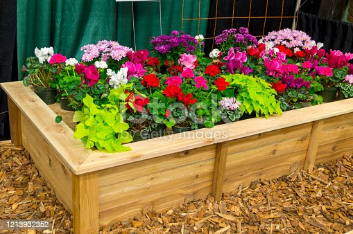 This is an example of a wooden flower planter box on display at a home and garden show.