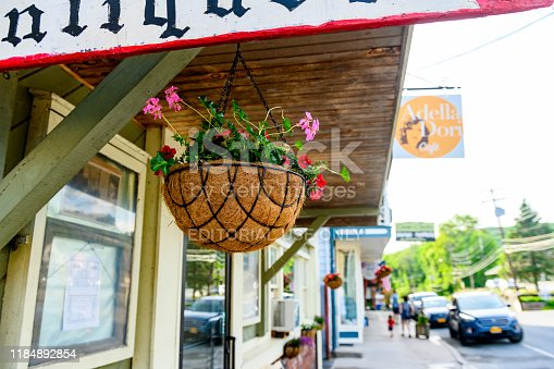 In Callicoon, United States a flower planter hangs on the awning in front of a local business along Main Street in the small hamlet village in the Catskill Mountains of upstate New York.