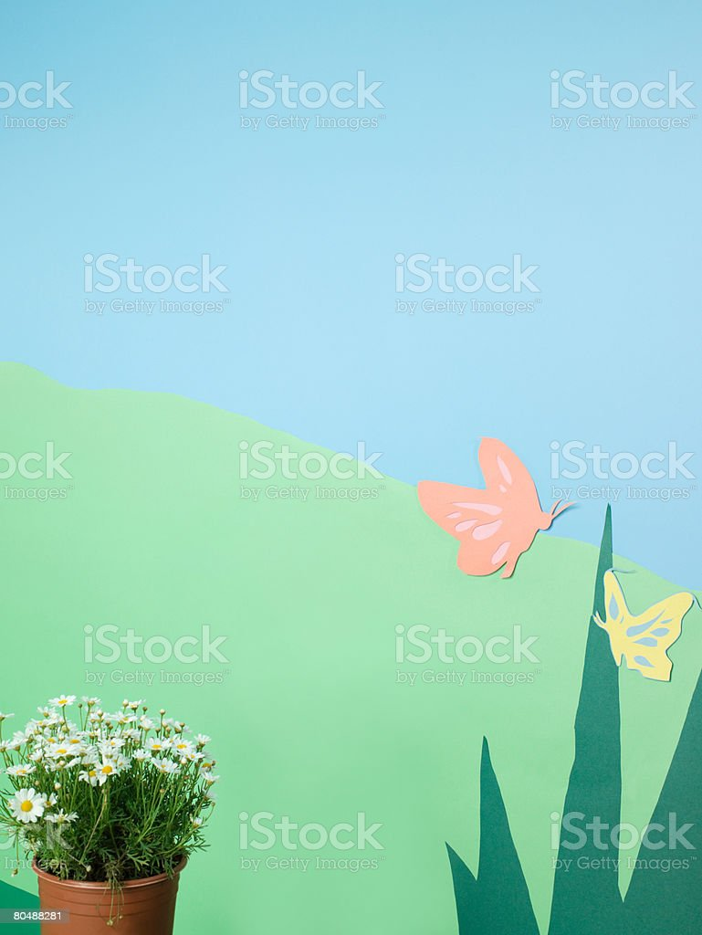 Flower pot and paper garden royalty-free stock photo