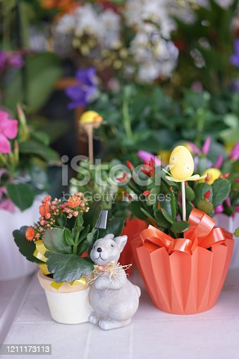 930928526 istock photo Flower pot. Cute and colorful flower pots with Easter bunny and Easter egg decoration. Flower shops are preparing for coming up for happy Easter event. 1211173113