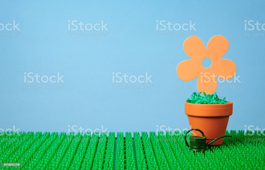 flower potted in clay pot stock photo