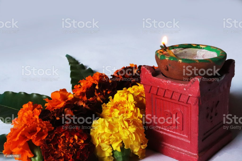 Flower Rangoli For Diwali Or Pongal Festival Made Using Marigold Or Zendu Flowers And Mango Leaf And Clay Oil Lamp Over White Background Selective Focus Image Stock Photo Download Image Now