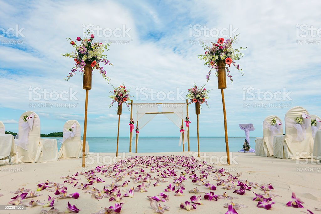 flower setting on the beach stock photo