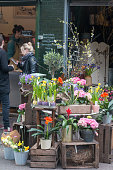 A florist in London Borough Market with people visible in the background