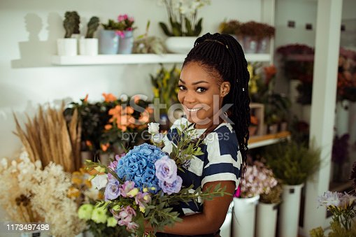 Close up of a young woman working in a flower shop
