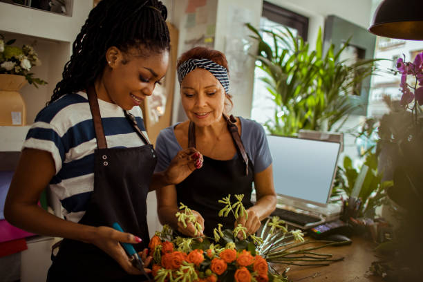 flower shop workers - small business owner stock pictures, royalty-free photos & images