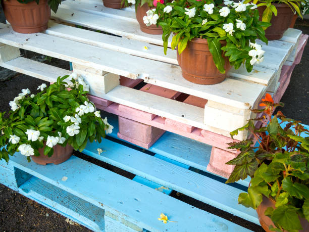 Flower stand made of painted wooden pallets stock photo