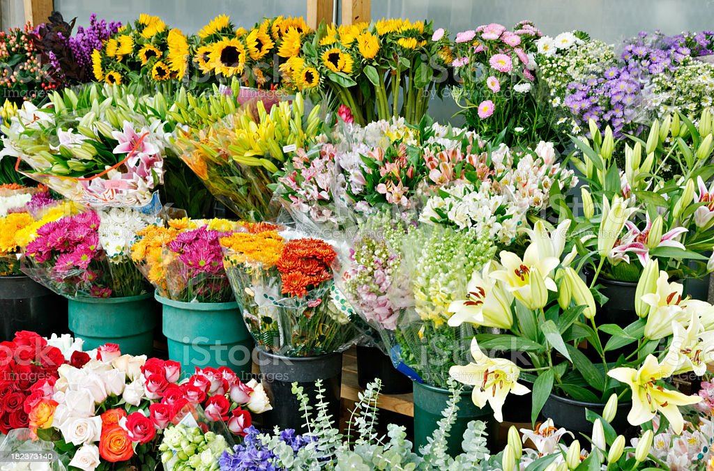 A flower stand outside a shop with a lovely variety royalty-free stock photo