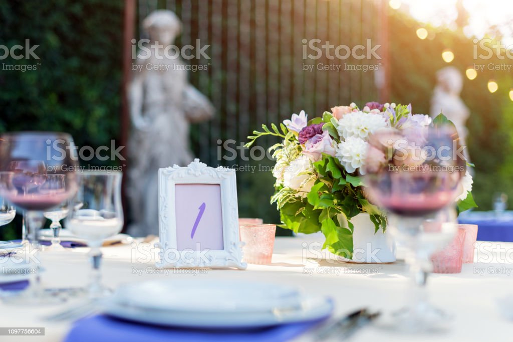 Flower table decorations for holidays and wedding dinner. Table set...