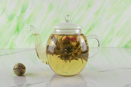flower tea in glass teapot