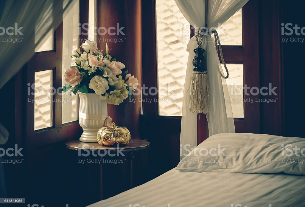 flower vase with decoration items placed on old wooden table stock photo