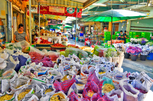 Flower vendor stall at the ICP Flower Market of Chinatown in Bangkok stock photo