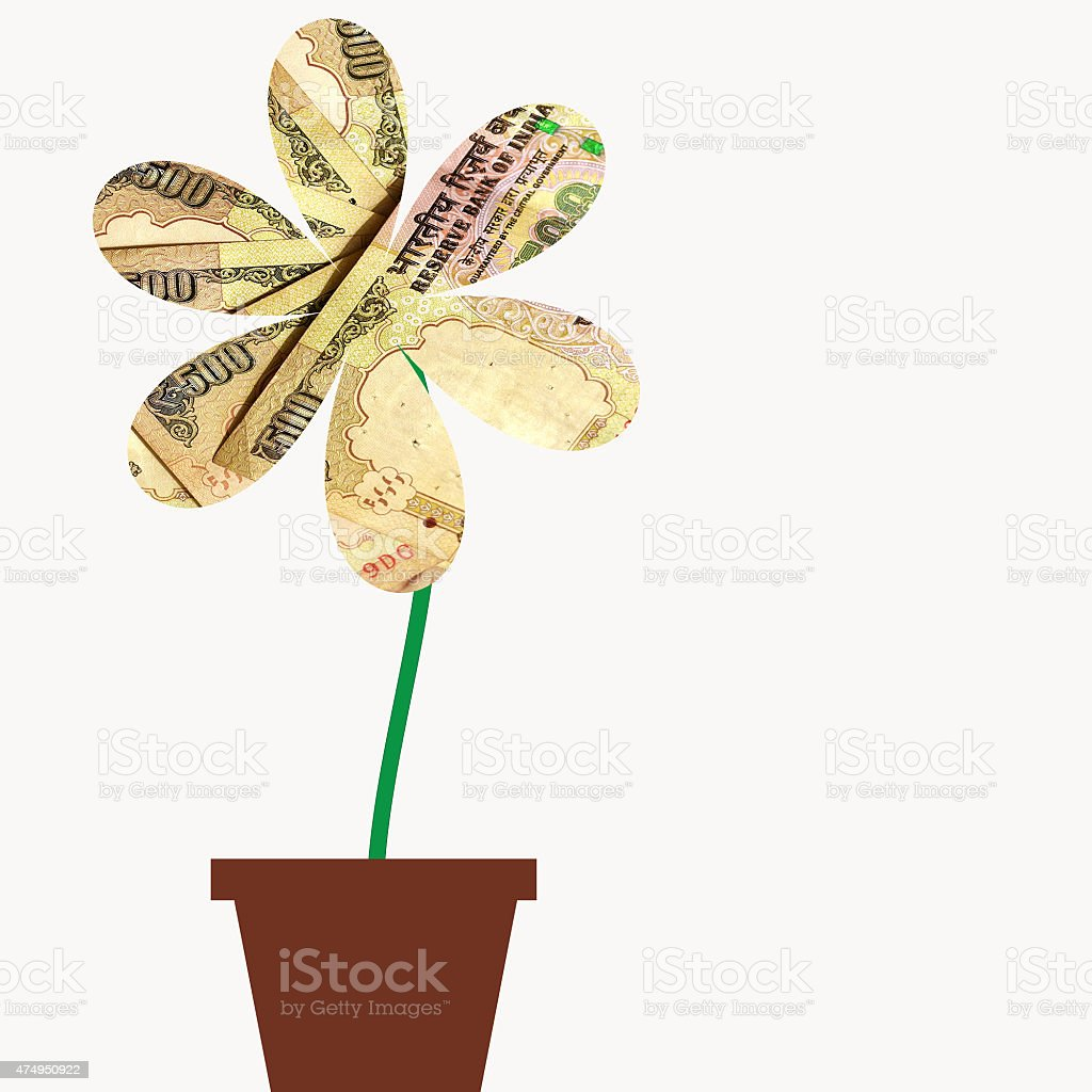 Flower with petals of India Rupee money currency stock photo