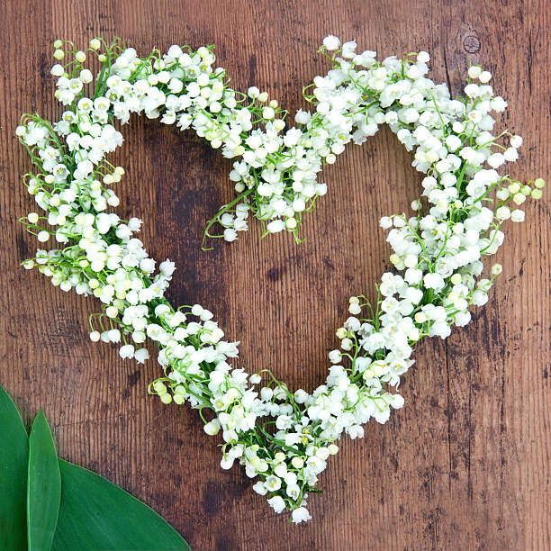 Flower wreath on rustic wooden background stock photo