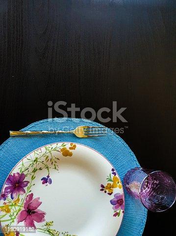 914465180 istock photo Flowered plate on blue 1193919182