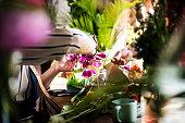 Flowerist arrange a blossom flower