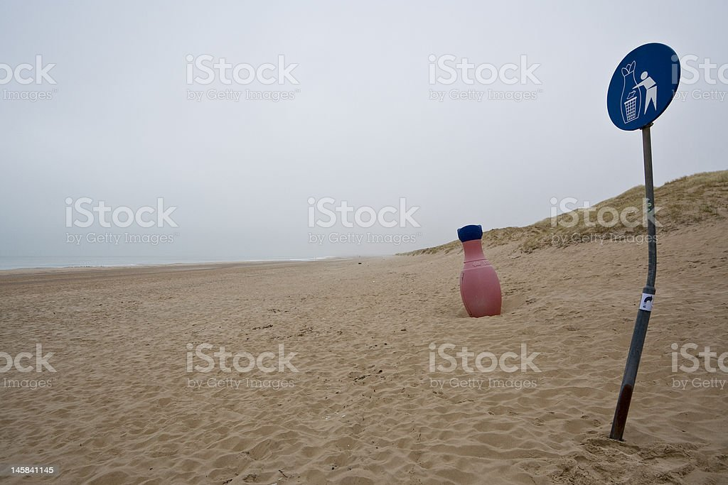 Flower-like trash can on beach royalty-free stock photo