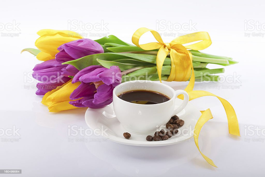 Flowers and a cup of coffee. royalty-free stock photo