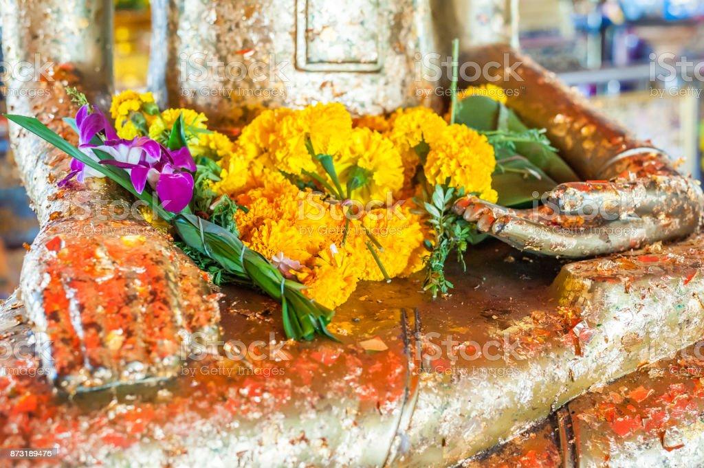 Flowers and buddha satue stock photo