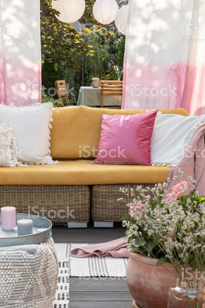 Peachy Flowers And Candles In Front Of Rattan Sofa With Colorful Cjindustries Chair Design For Home Cjindustriesco