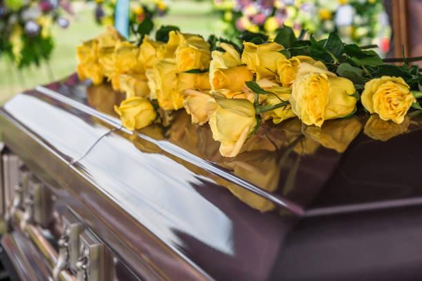 flowers and casket - funerale foto e immagini stock