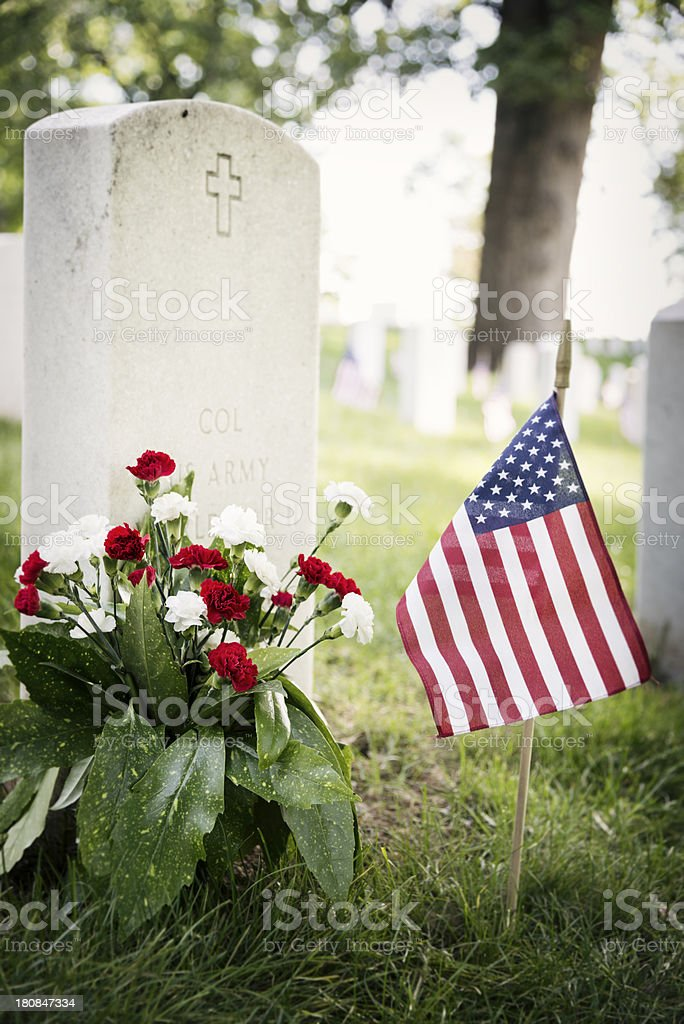 Flowers and Flag at a Soldier's Grave royalty-free stock photo