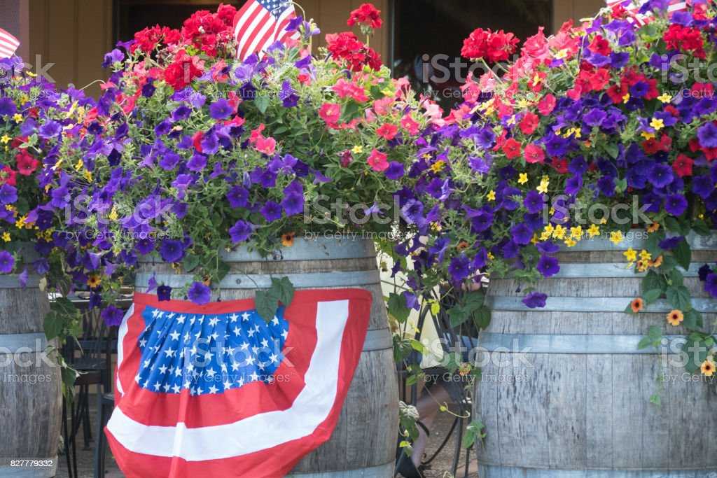Flowers and flag celebration of Fourth of July stock photo