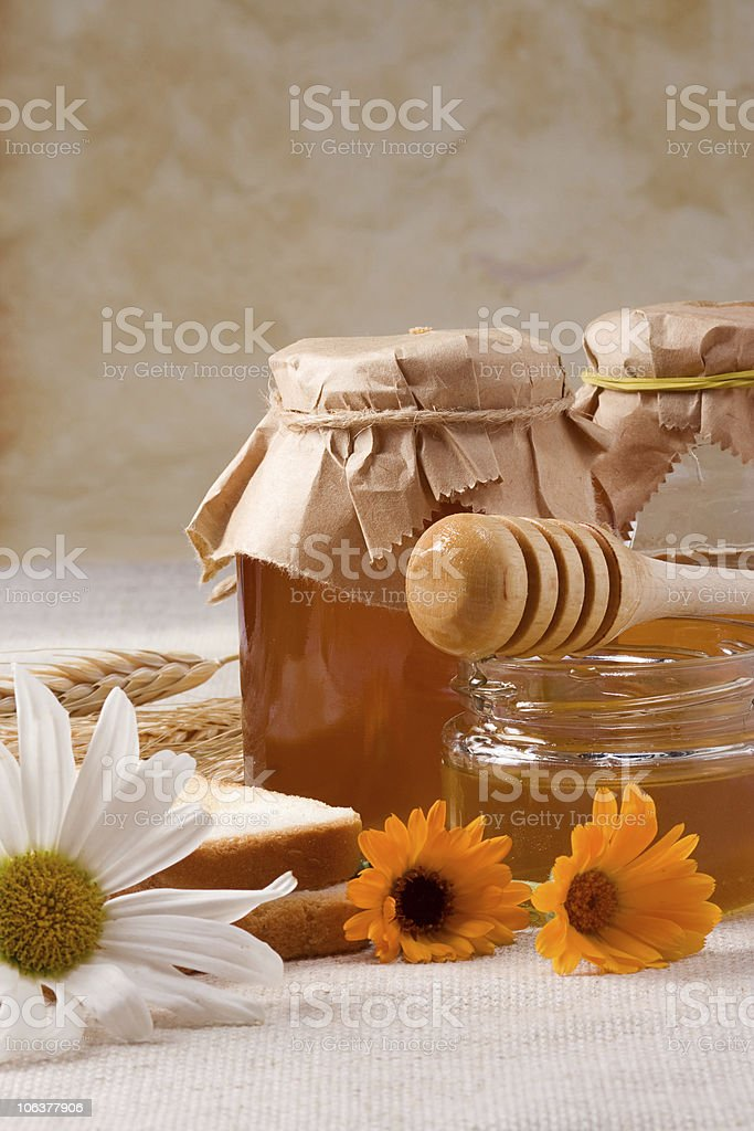flowers and honey on sacking royalty-free stock photo