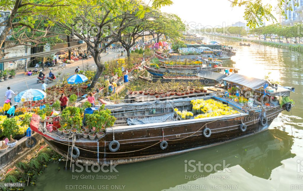 Flowers at the flower market along the canal wharf. stock photo